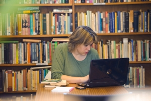 Female student studying with laptop