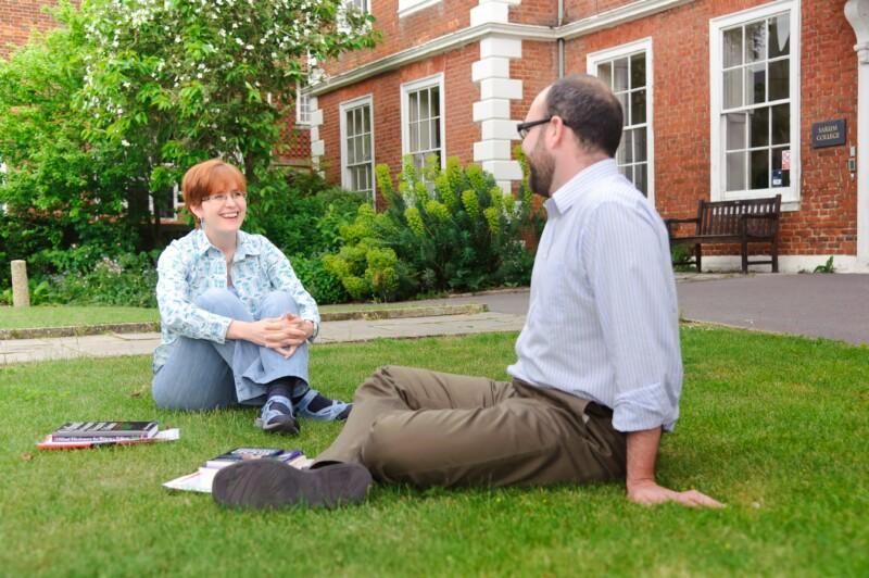 sarum-college-students-talking-sitting-grass
